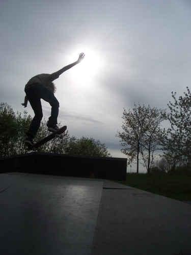 Vykort skateboardollie